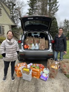 Ilyse Smith (left) of USR is collecting donations for Paterson's poor.
